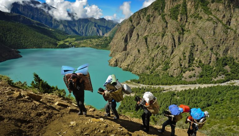 Top Trekking in Nepal   Trekkers hiking along Phoksumdo lake in lower Dolpo, Nepal.