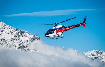 A chopper flying parallel to Himalayas while undergoing Helicopter Tours in Nepal
